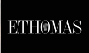 E.THOMAS